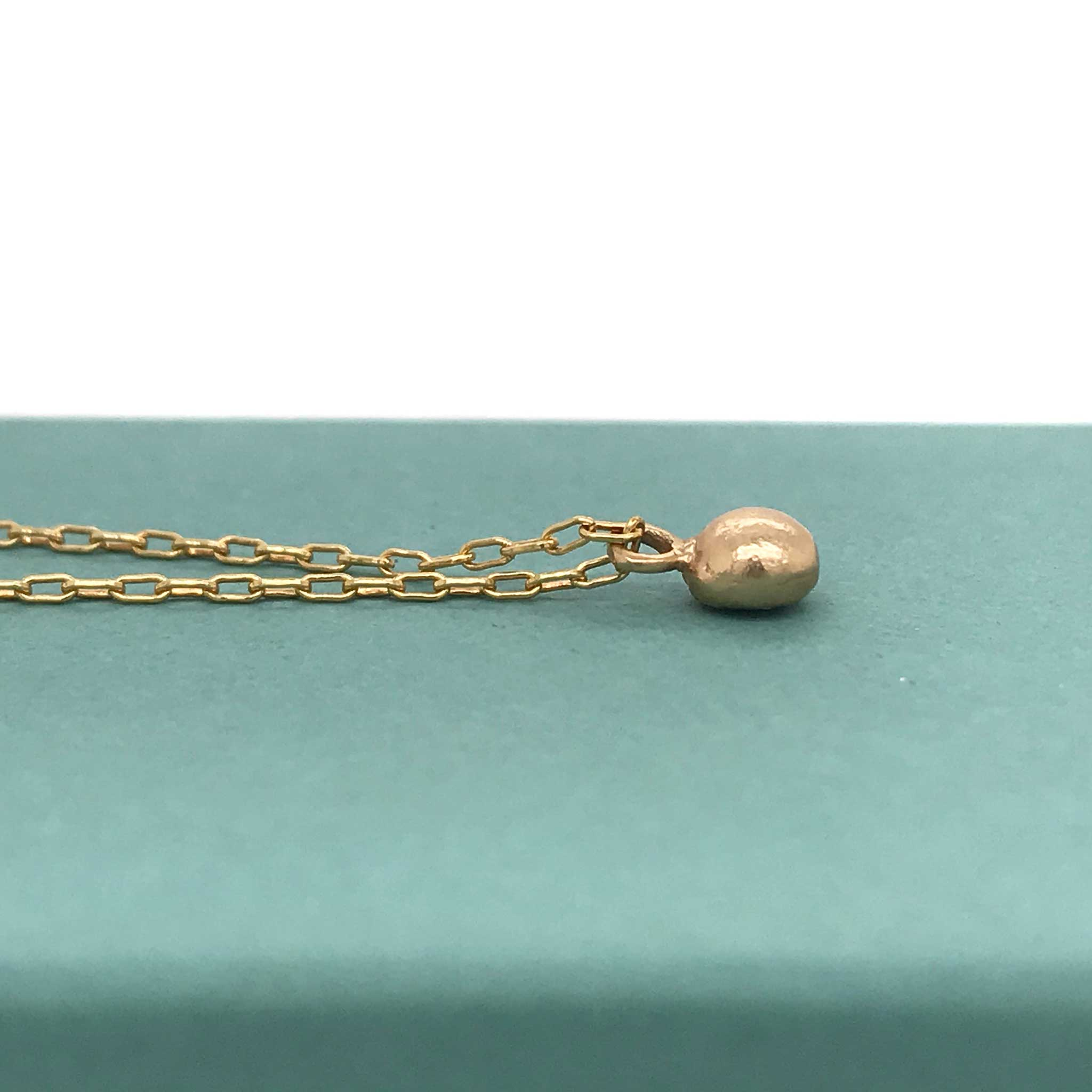 solid gold pebble charm necklace kriket broadhurst jewelry Sydney