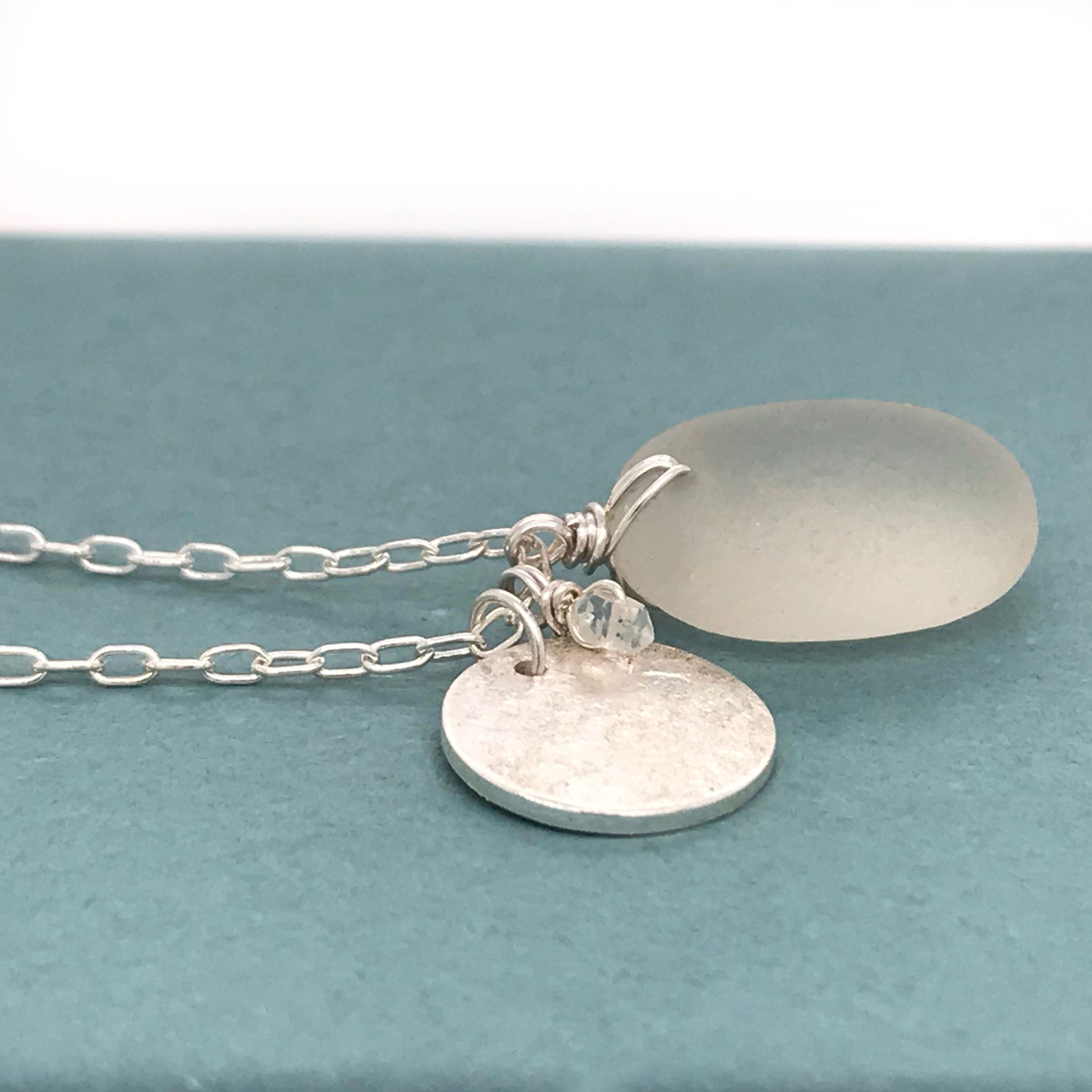 sterling silver disc charm necklace with clear seaglass and aquamarines kriket broadhurst jewellery