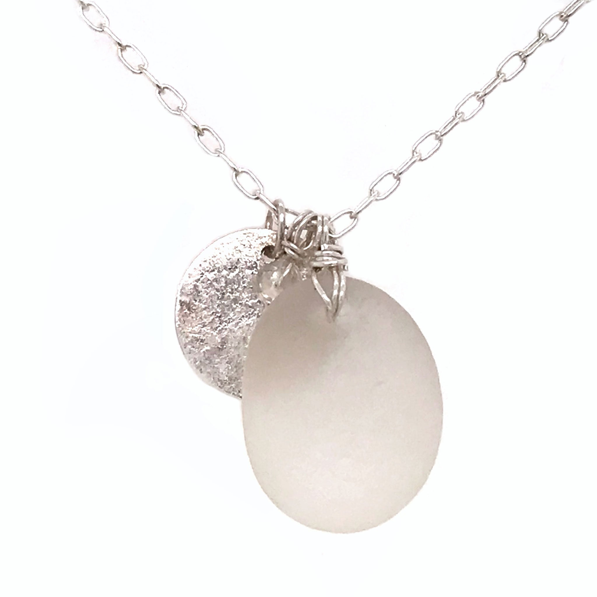 clear seaglass pendant on silver necklace with silver disc charm kriket broadhurst jewellery