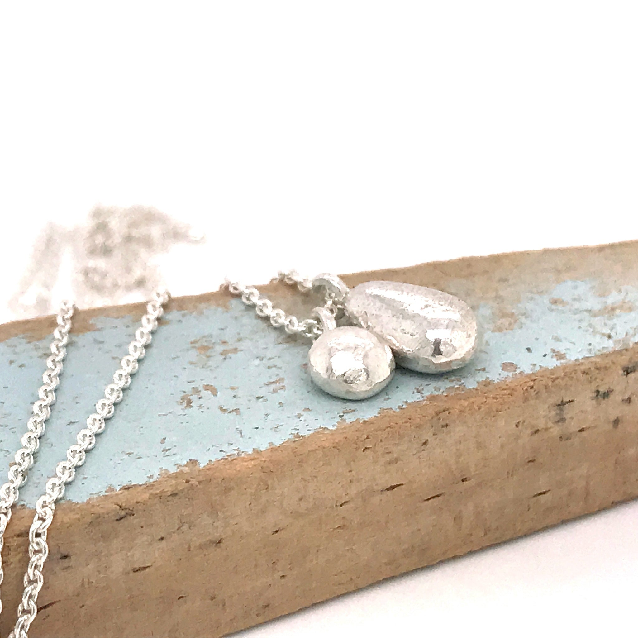 charm necklace in sterling silver kriket broadhurst jewellery