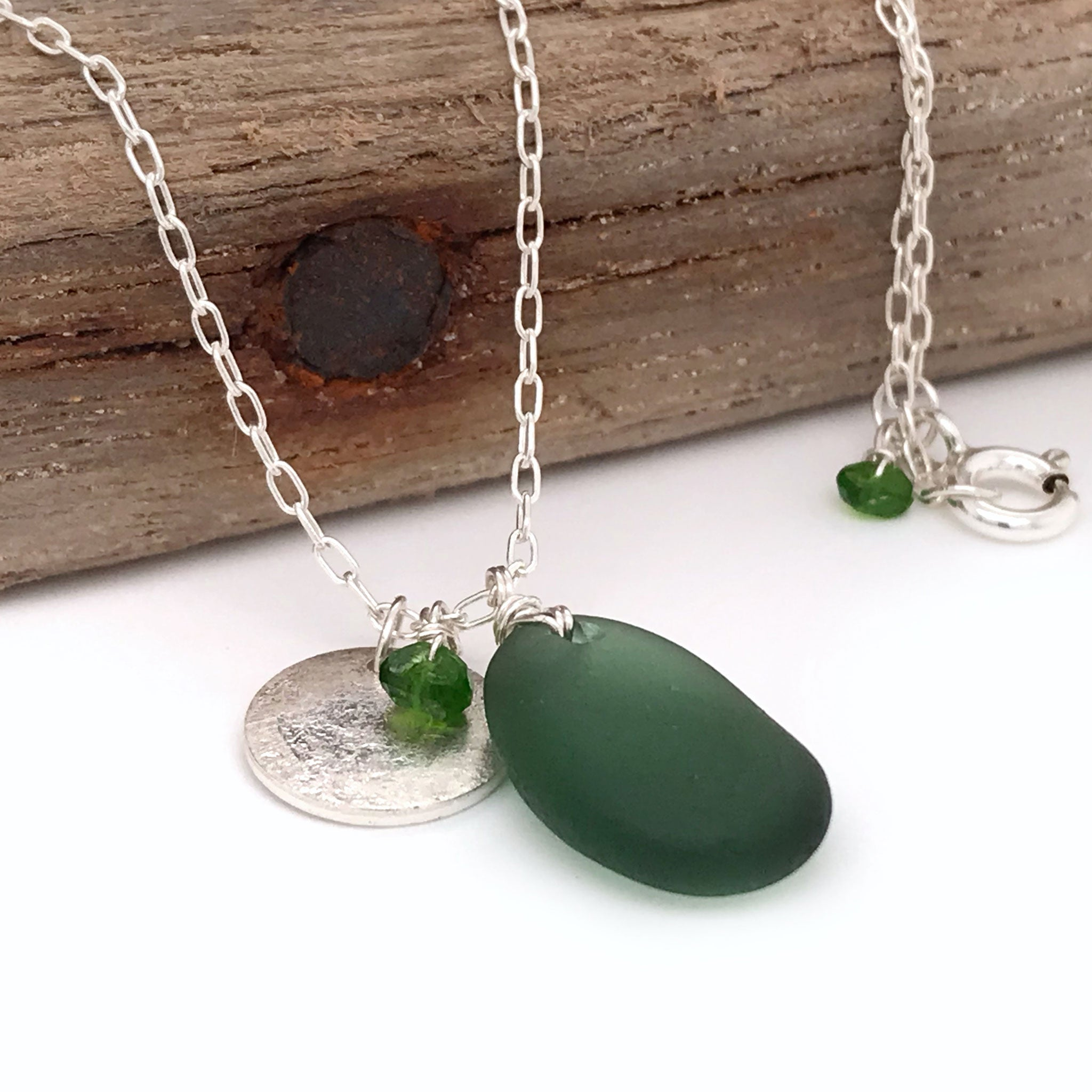 sterling silver disc necklace with green seaglass and tsavorite stones kriket Broadhurst jewellery