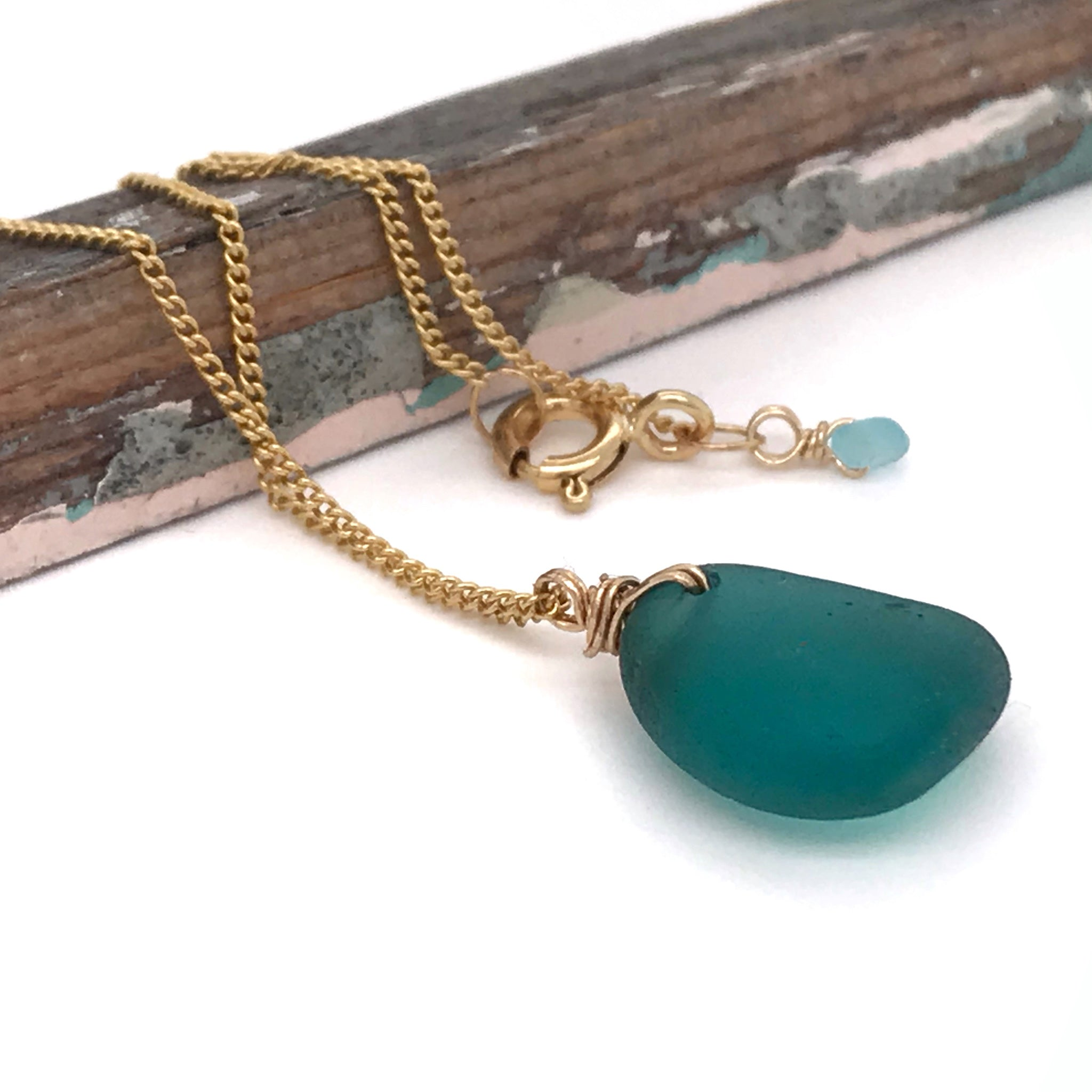 teal green necklace ocean glass on gold chain kriket broadhurst jewelry