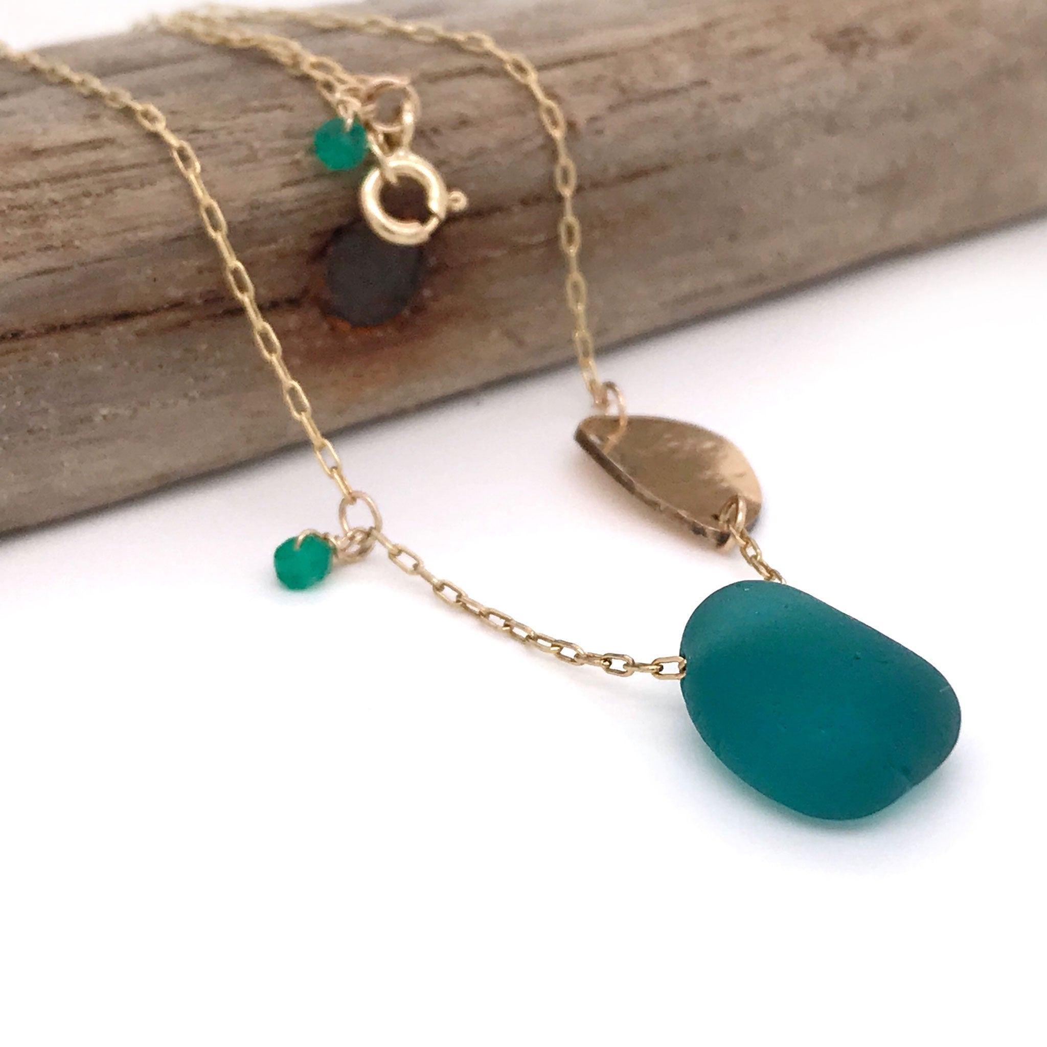 gold necklace with teal seaglass and leaf charm kriket Broadhurst jewellery