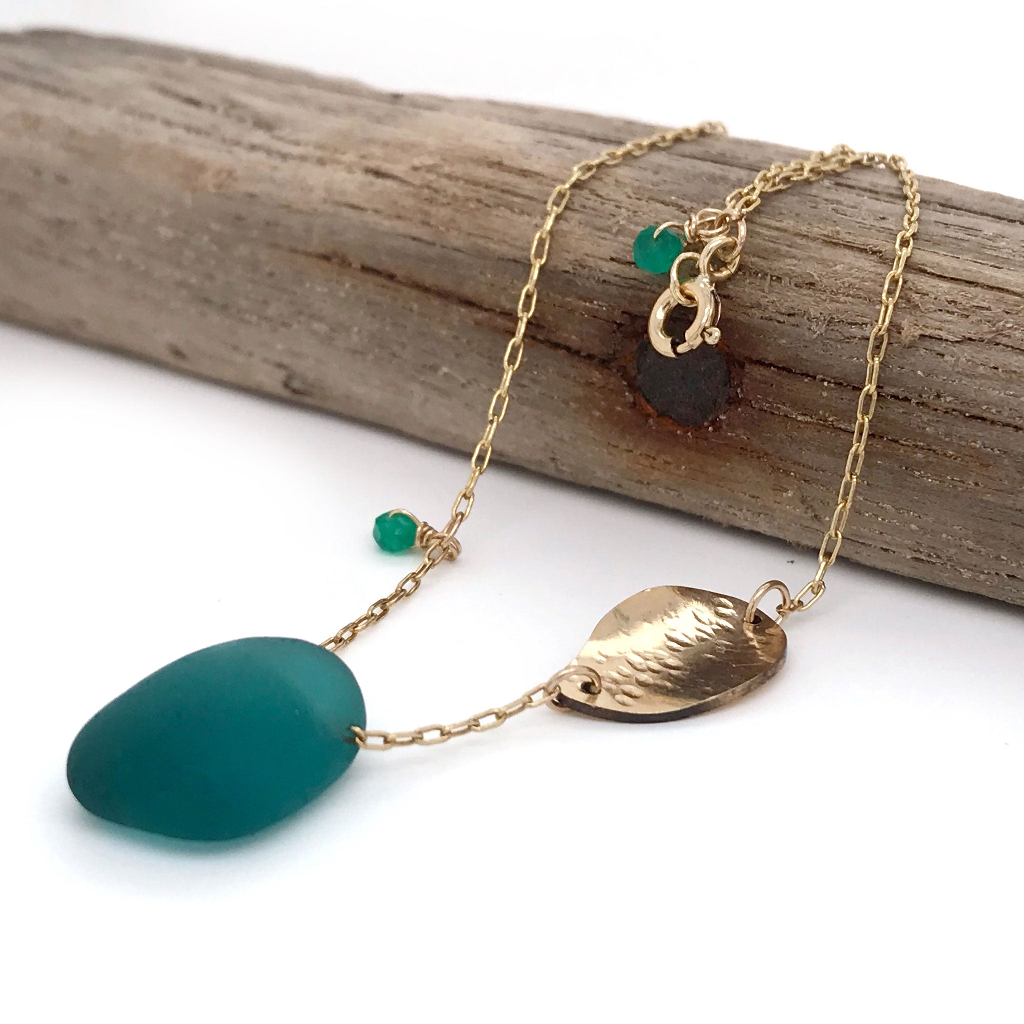 teal green beach glass necklace with gold leaf charm Kriket Broadhurst jewellery