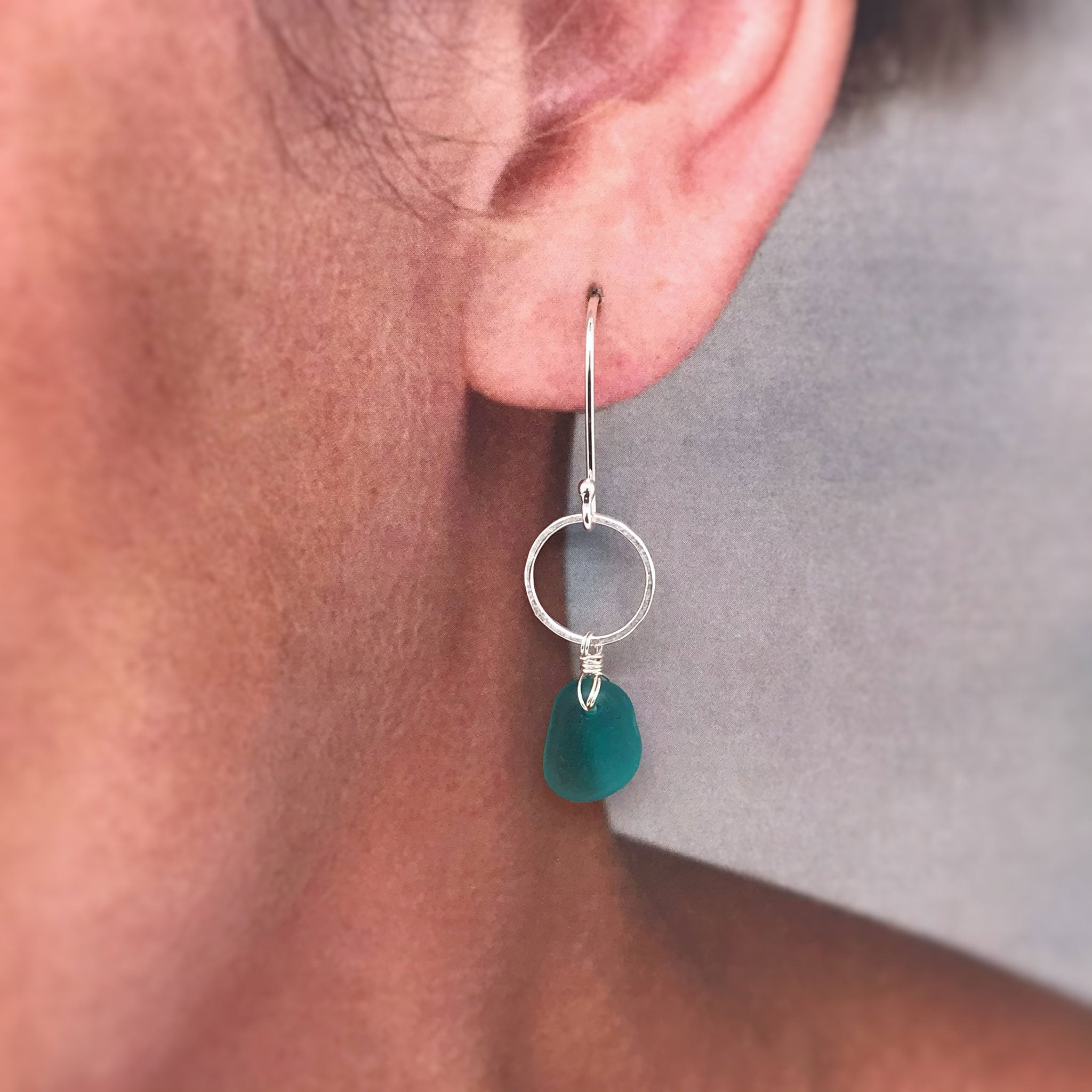 sterling silver earrings circle design with teal seaglass Kriket Broadhurst jewellery