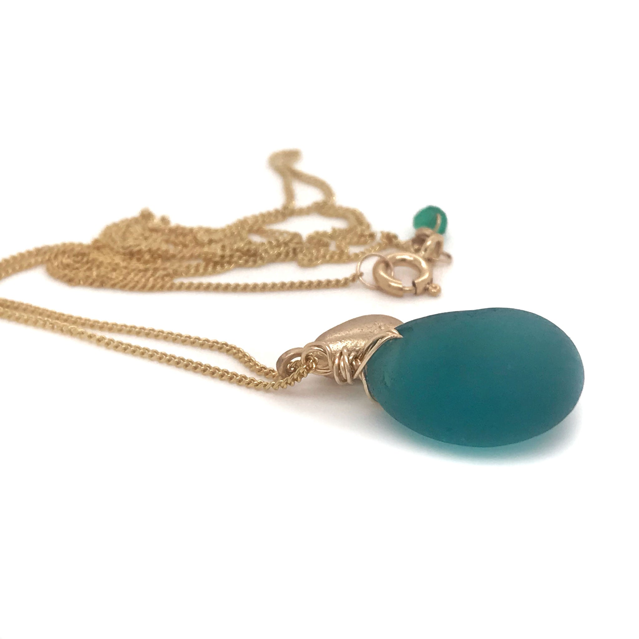 teal seaglass necklace on gold chain with solid 14k gold charm Kriket Broadhurst handcrafted jewellery
