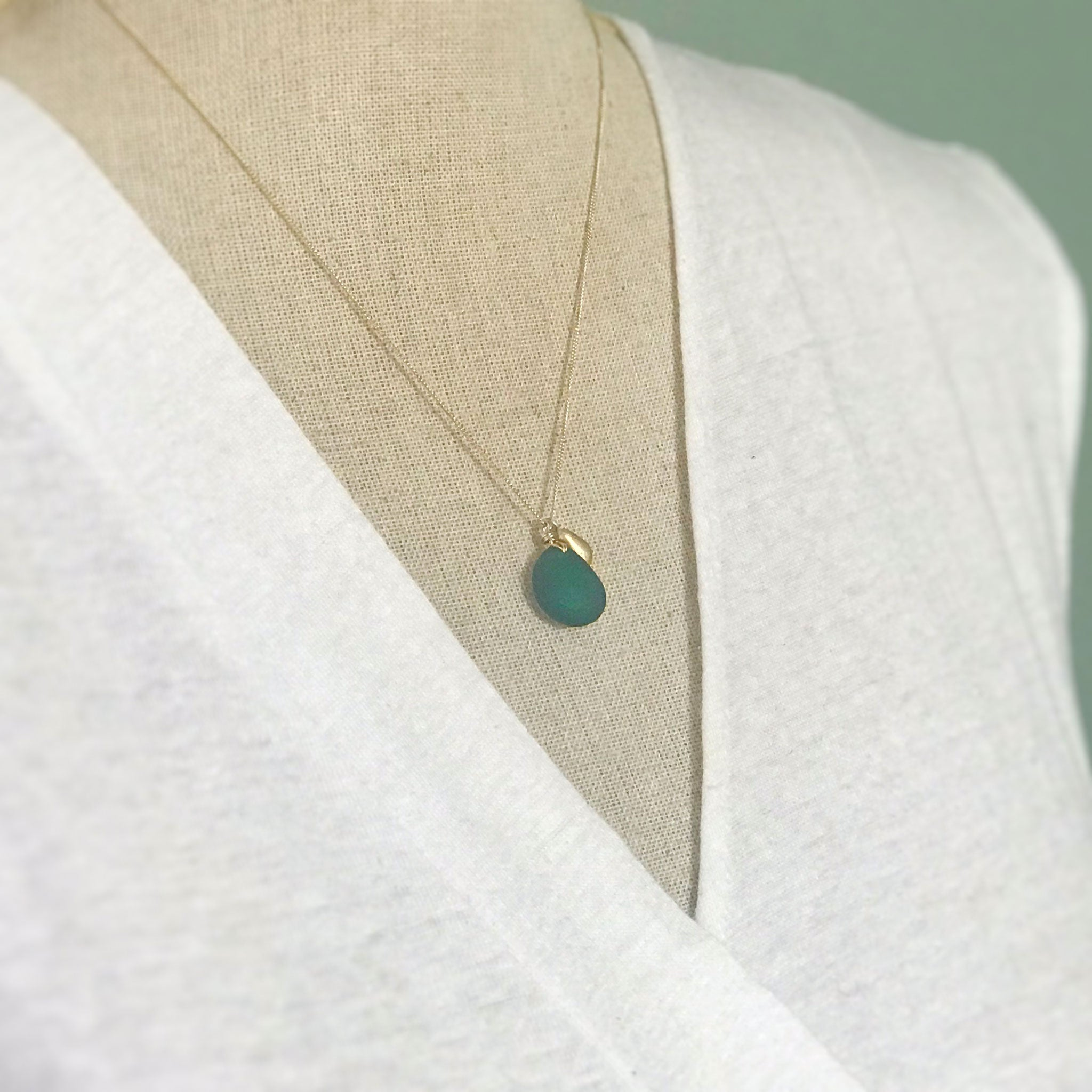 teal seaglass necklace on gold chain with solid 14k gold teardrop charm Kriket Broadhurst jewellery Australian made