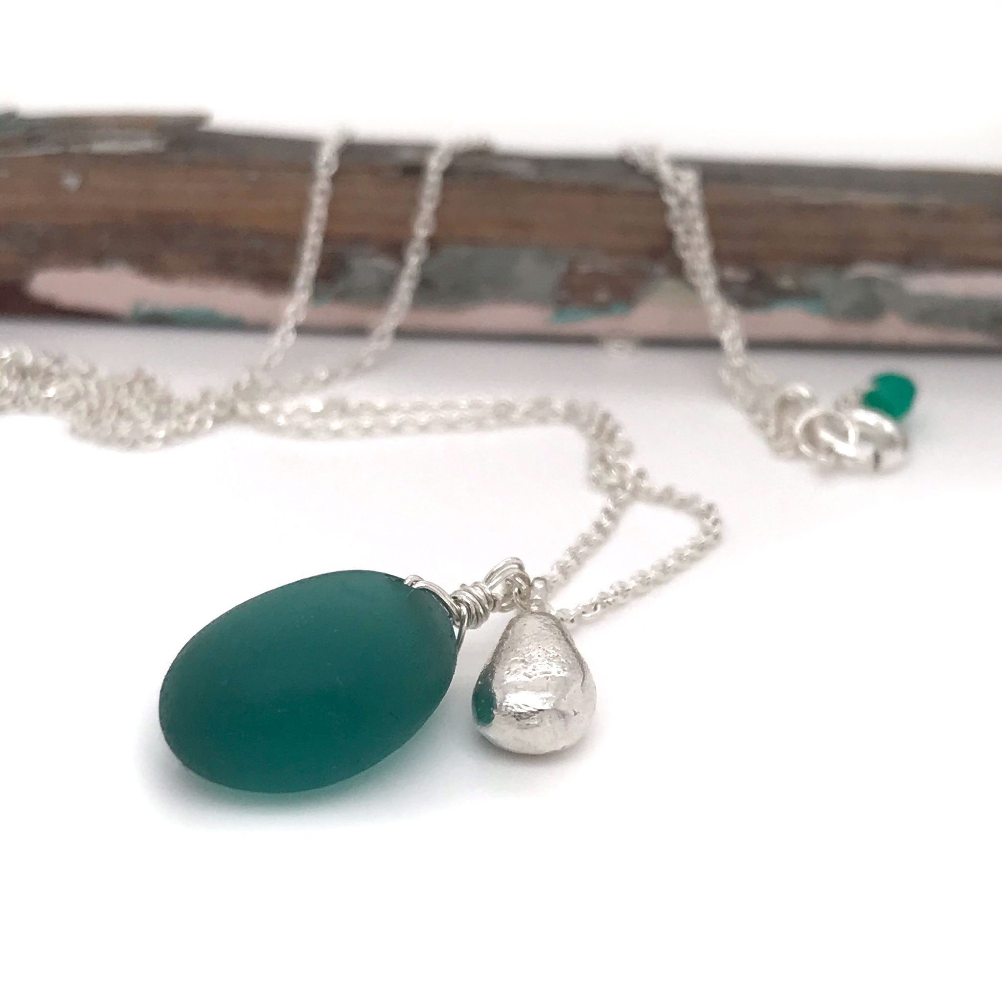 teal seaglass necklace on sterling silver chain with solid silver teardrop charm Kriket Broadhurst jewelry