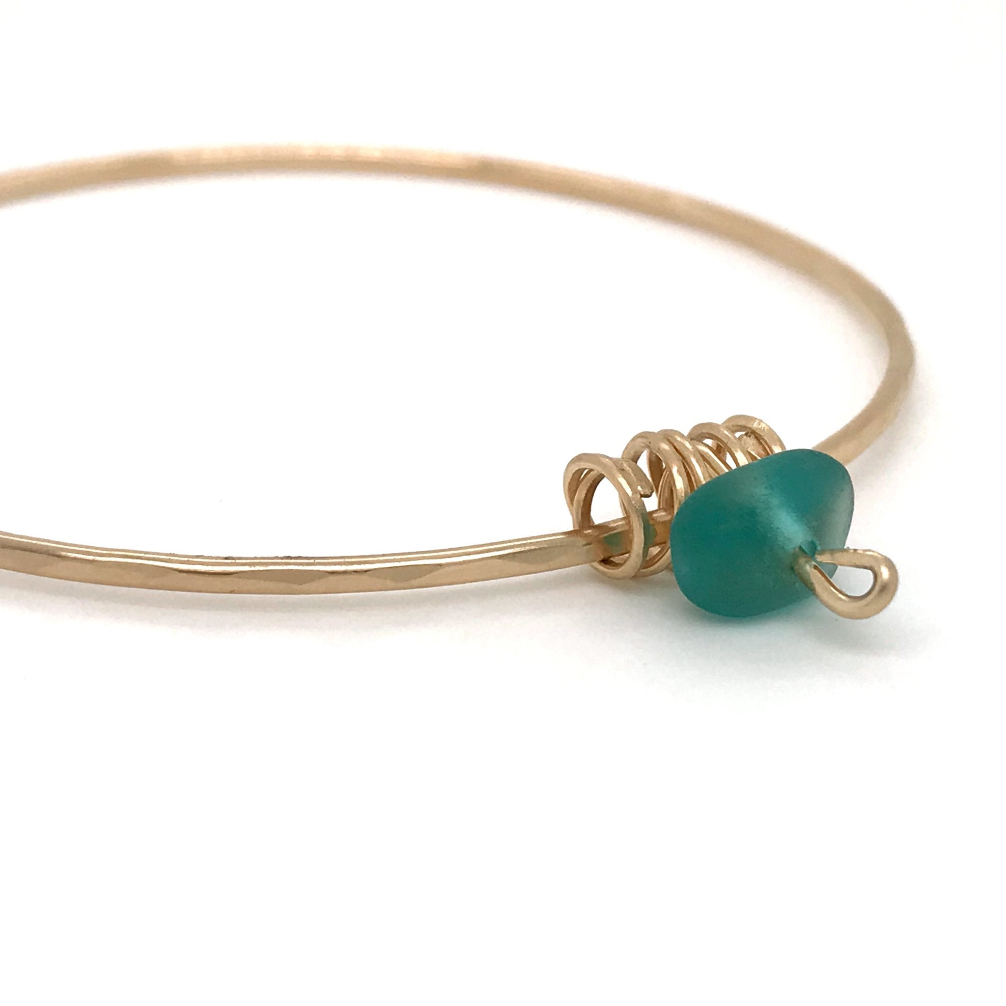 gold bangle with teal seaglass Kriket Broadhurst jewellery