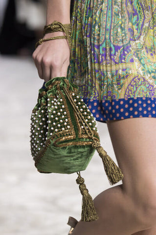 A Cinch drawstring bag being carried down a Runway
