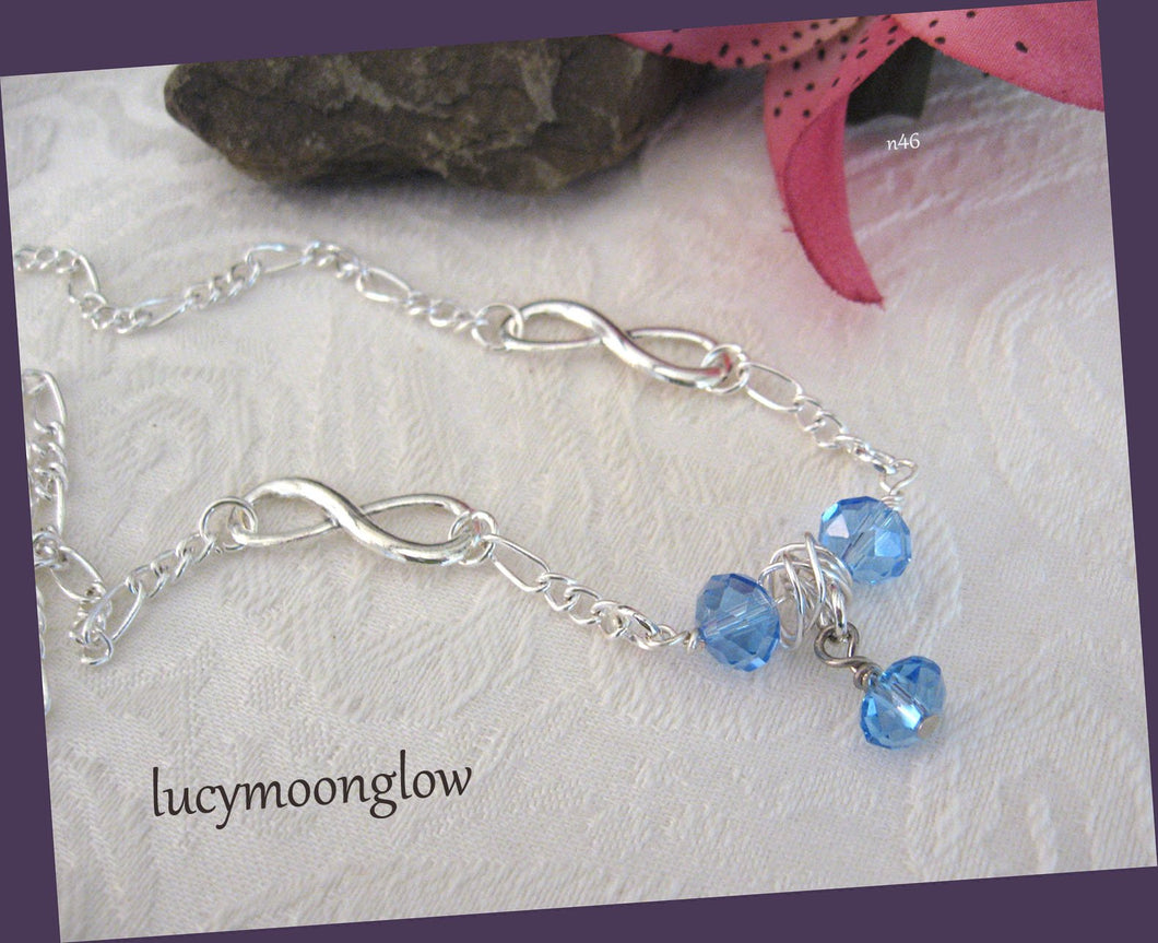 Blue Crystal and Infinity Necklace