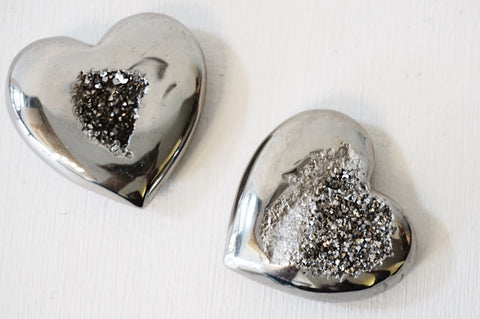 Two titanium plated druzy crystal hearts