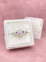 White Gold Round Cut & Blue Sapphire Halo Twisted Engagement Ring | 0.63 Carat Total Weight