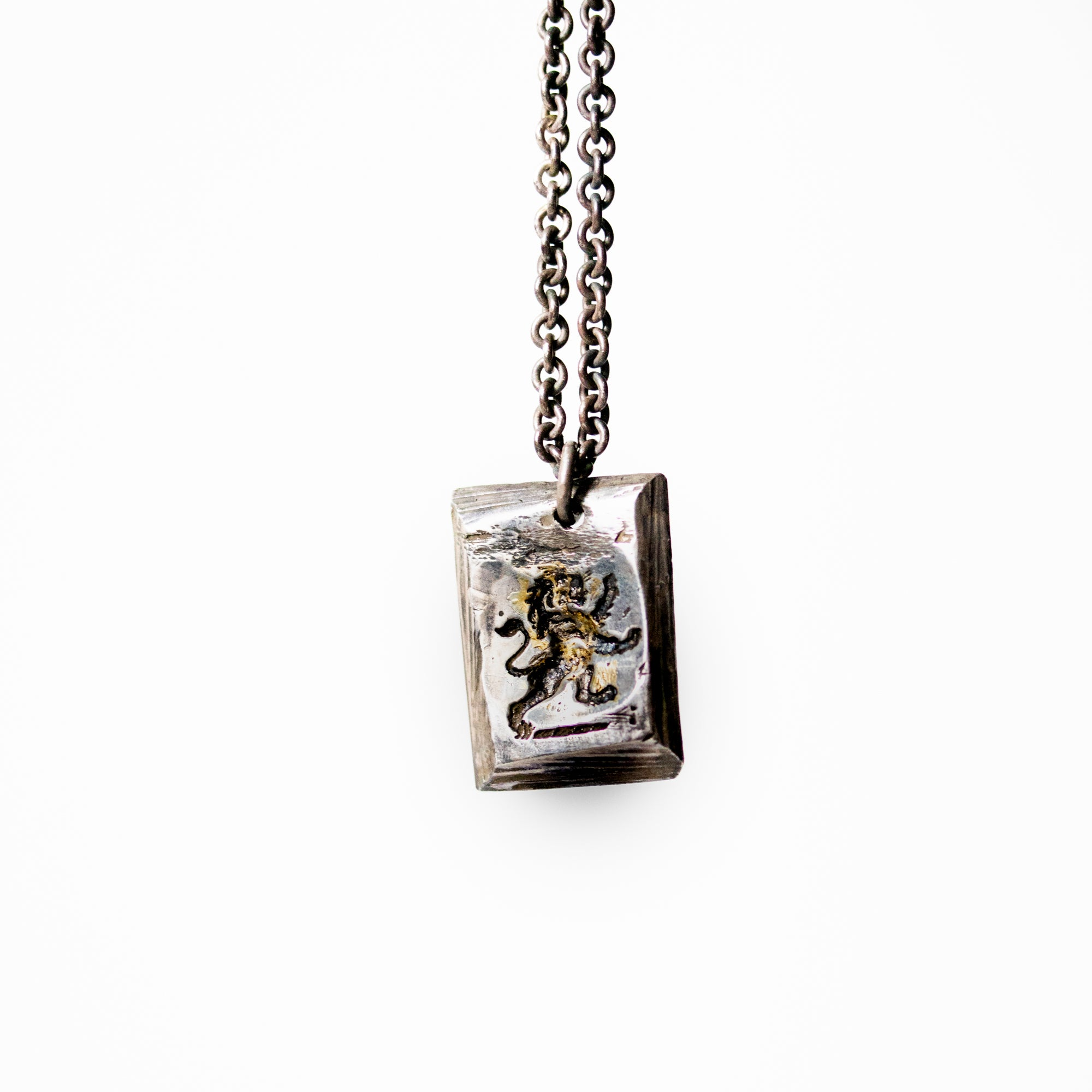 Illuminated Lion Tag Necklace - Machinations