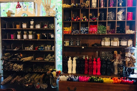 candle and herb selection at muses of mystery
