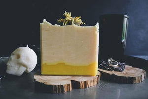 bright yellow white soap with gothic skull in moody setting