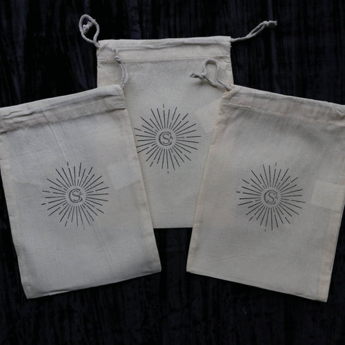 starburst hand stamped cotton drawstring bag