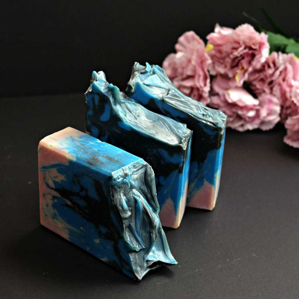 glossy blue black pale pink soap bars with romantic mauve flowers