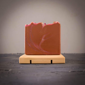 natural soap on wooden soap dish