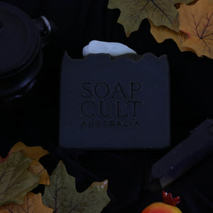 black activated charcoal soap with raven skull embedded for halloween spook
