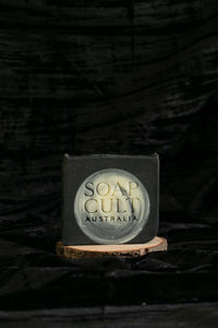 soap cult australia full moon soap with stamp on wooden riser velvet backdrop