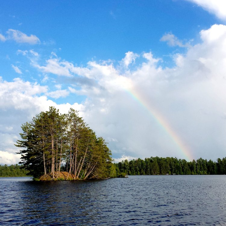 rainbow over the lake in northern wisconsin