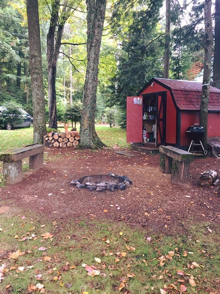 tool shed and fire pit at a cabin in northern wisconsin