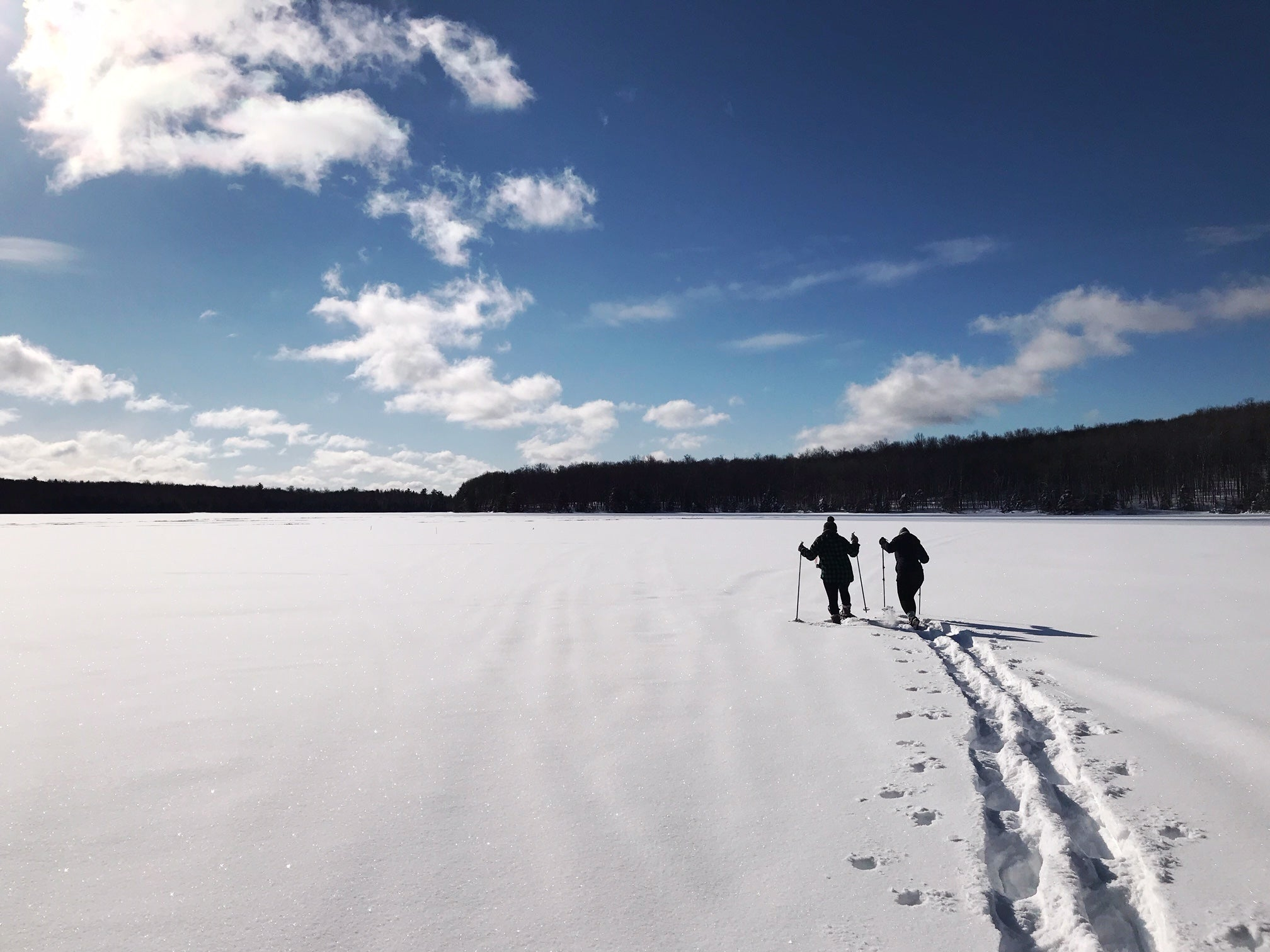 snowshoeing on a frozen lake wisconsin northwoods