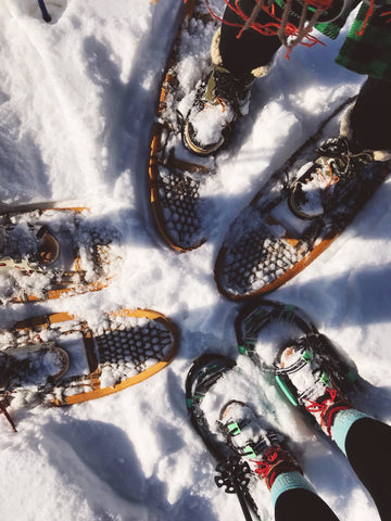 group of snow shoes on feet
