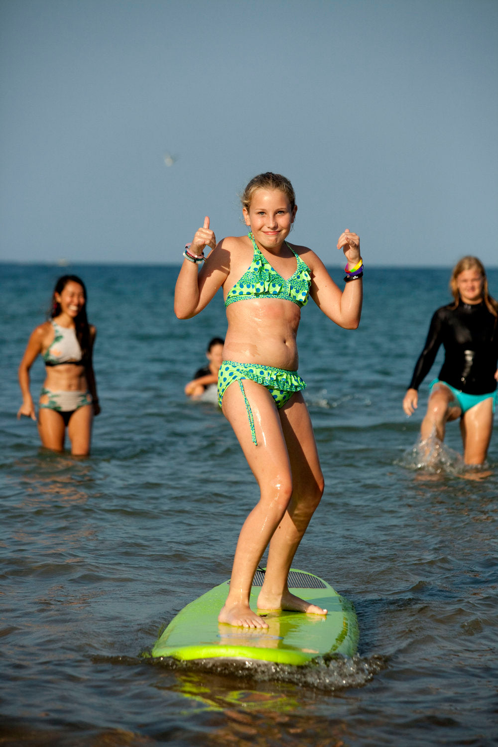 girl learning how to surf at surfrider event milwaukee