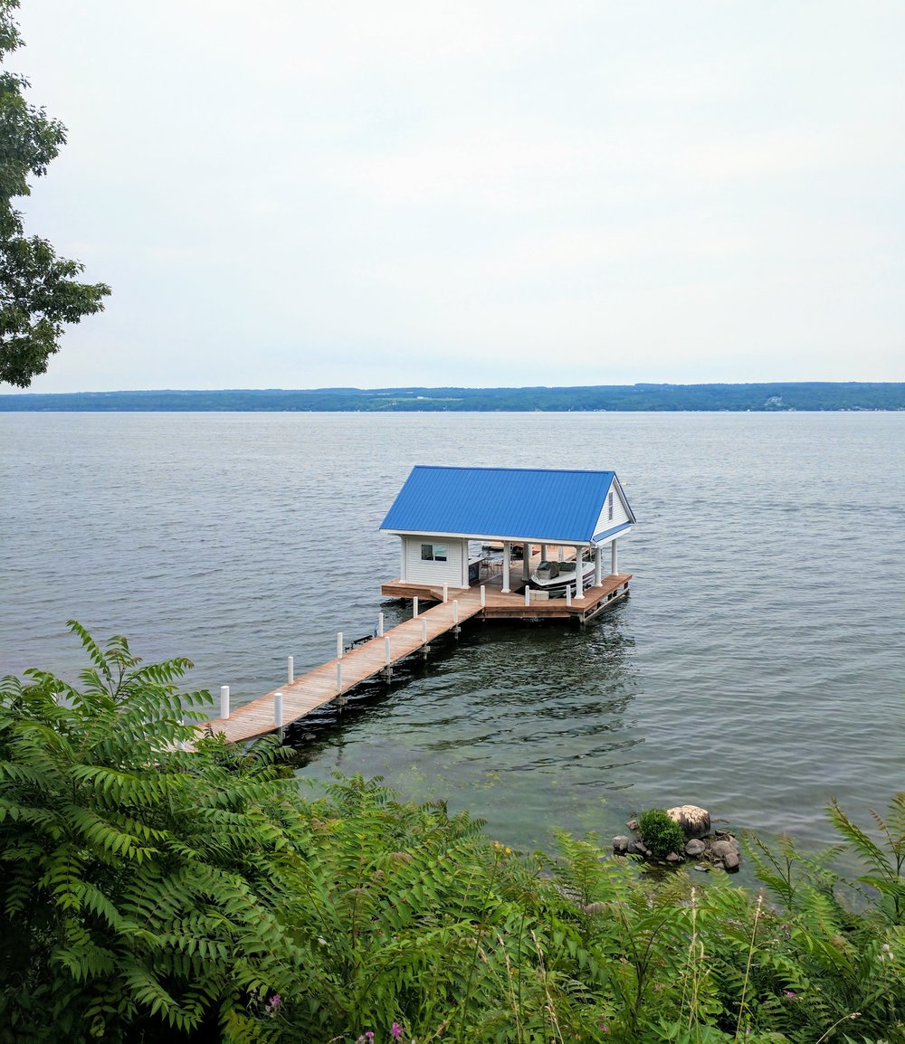 small boat house on a pier finger lakes