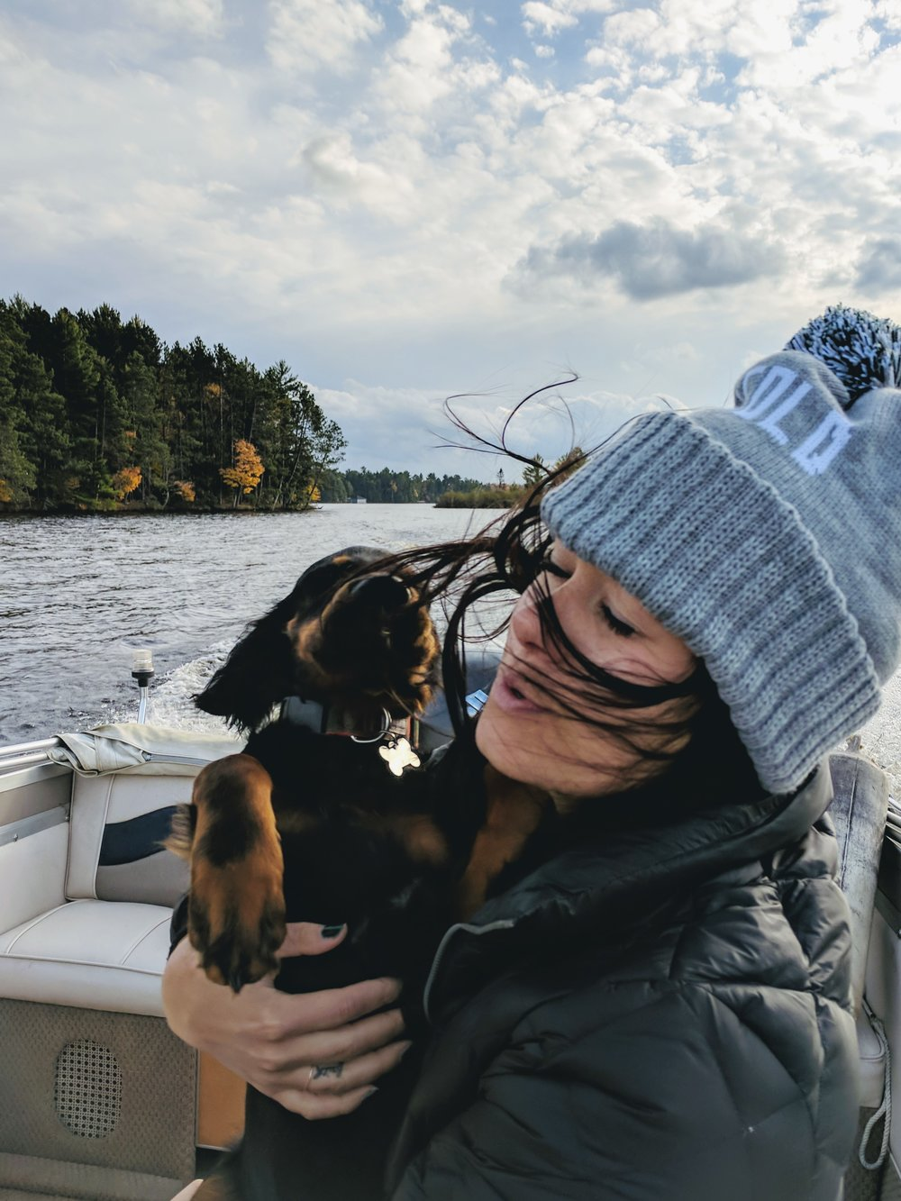 so cold winter hat on the boat with a dog