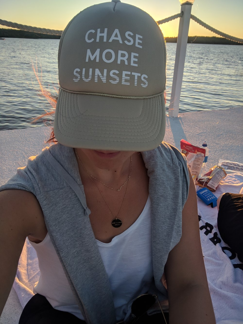chase more sunset trucker hat on the pier