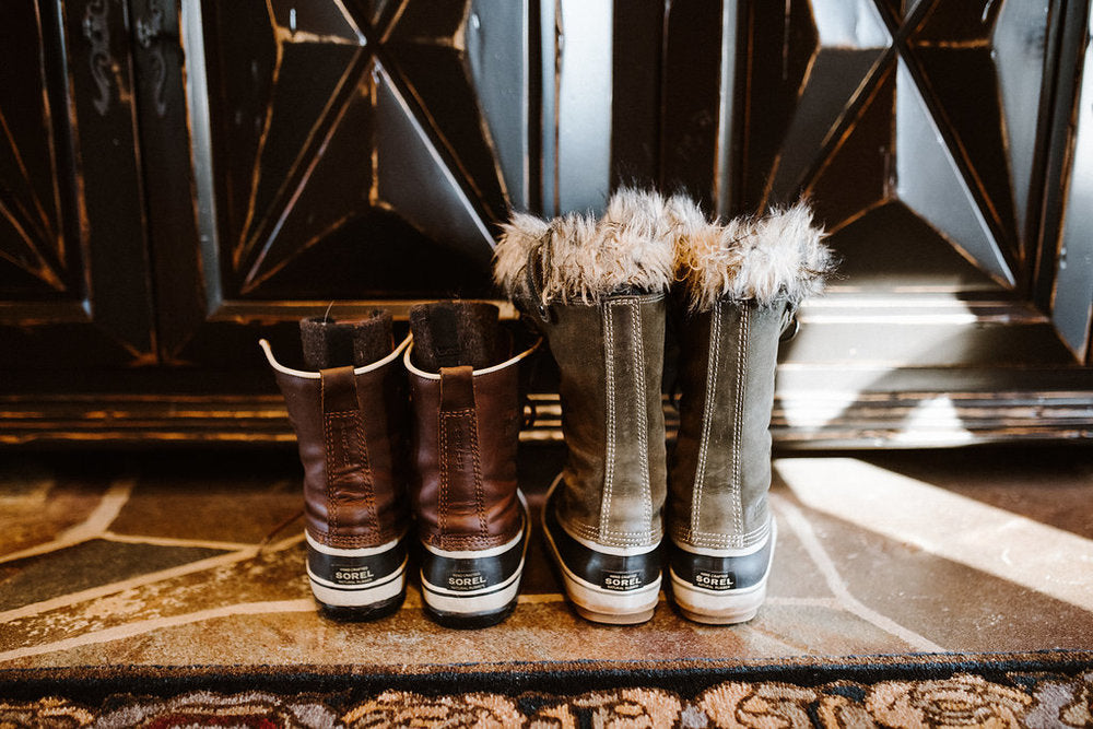 sorel winter boots drying by the fire