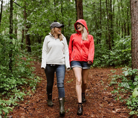 two women laughing and hiking the northwoods wisconsin