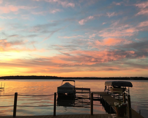 sunset on the lake boat pier dock