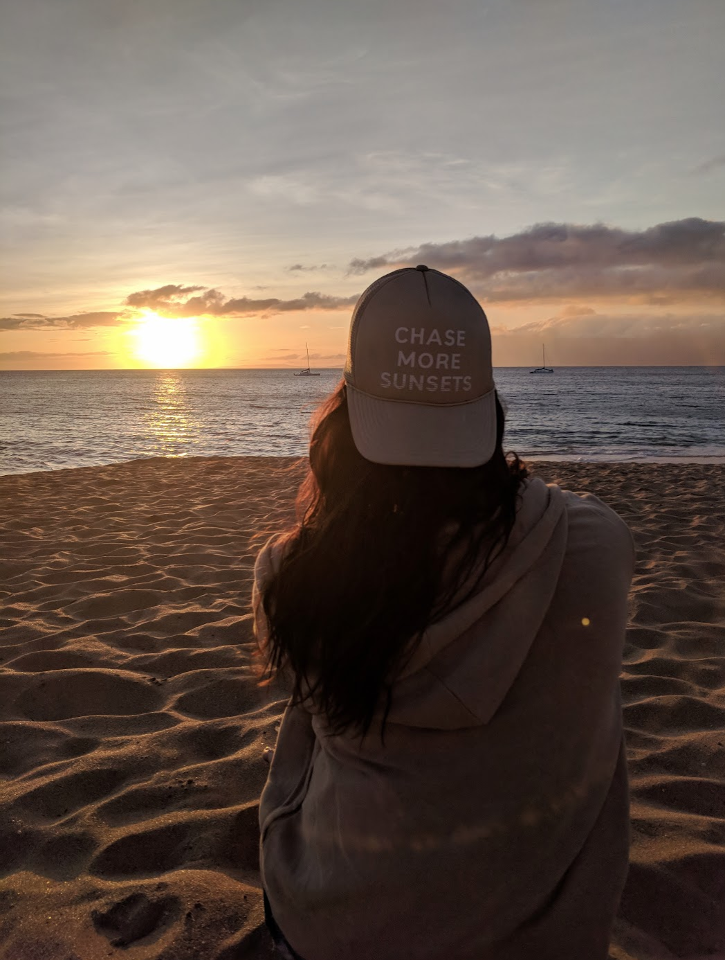 chase more sunsets trucker hat on the beach watching the sunset