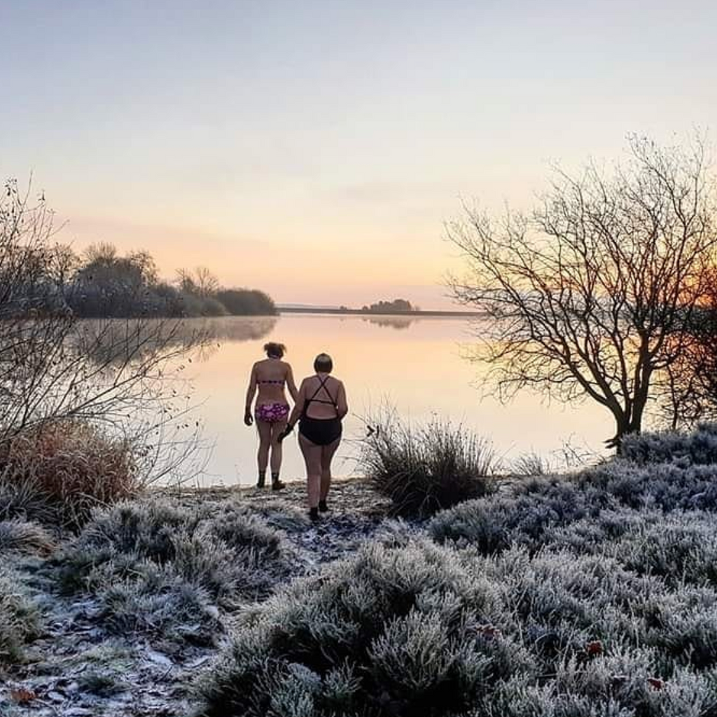 Two Girls Swimming in a cold lake during winter swim club