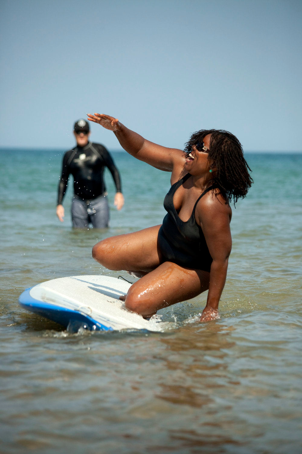 woman learning to surf at the surfrider milwaukee event