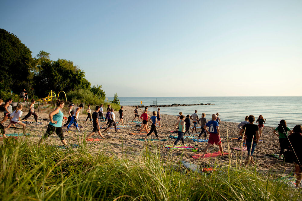 Morning Yoga on the beach for surfrider milwaukee