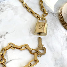 Load image into Gallery viewer, Louis Vuitton Set Lock Geometric Chain Necklace and Key Bracelet