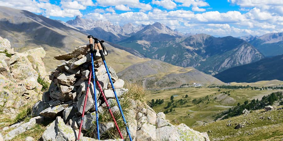 Trekking poles do have varying sizes. You don't have to worry about your height because trekking poles are adjustable.