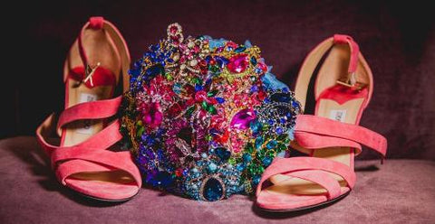 This is an image of a bling brooch bouquet full of coloured brooches for a wedding