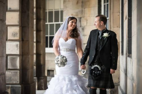 Traditional wedding with a silver brooch bouquet for a bride as a wedding keepsake