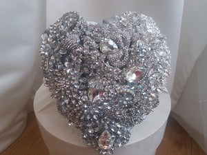 This is an image of our Crystal Heart Silver Brooch Bouquet For a Wedding In stock