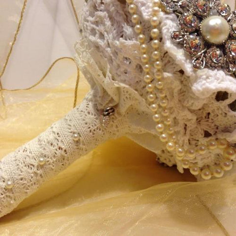 This is an image of a lace bouquet handle for a 1950s wedding