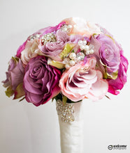 Load image into Gallery viewer, This is a side image of our lilac and pink brooch rose artificial wedding bouquet with pearls and crystals for a bride