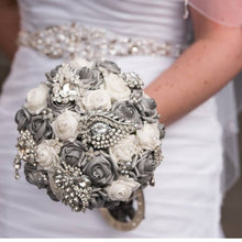 Load image into Gallery viewer, This is an image of a bride holding her Luxurious Silver Crystal Brooch Wedding Bouquet For A Traditional Wedding - Bridal Crystal Bouquets