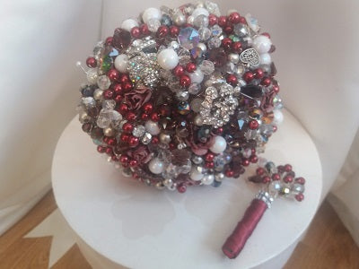 This is an image of our Merlot crystal wedding bouquet with pearls for a bride