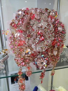 This is a close up image of our Fabulous Sparkly Pretty In Pink Crystal Brooch Wedding Bouquet Keepsake by Bridal Crystal Bouquets